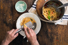 Man is having supper Italian pasta on rustic wooden table Stock Image