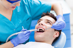 Man having teeth examined at dentists Stock Photo