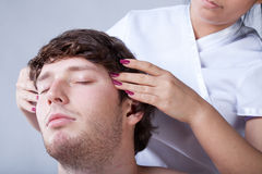 Man having temples massage Royalty Free Stock Photography