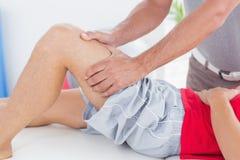 Man having thigh massage Stock Photography
