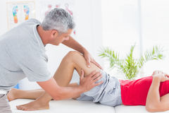 Man having thigh massage. In medical office royalty free stock images