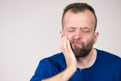 Man having tooth pain. Portrait of adult man suffering from tooth pain ache. Dental problem, health issues concept stock images