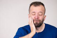 Man having tooth pain. Portrait of adult man suffering from tooth pain ache. Dental problem, health issues concept royalty free stock image