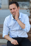 Man having toothache outside royalty free stock images
