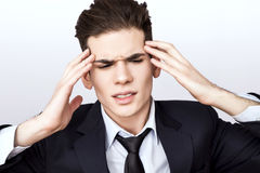 Man having trouble. Businessman having headache after work Royalty Free Stock Photo