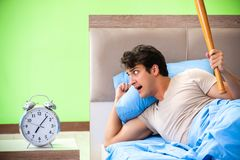 The man having trouble with his sleep stock image