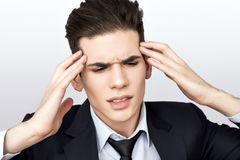 Man having trouble. Man holding his head having a headache Stock Images