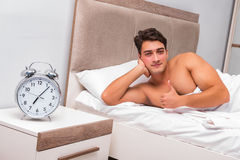 The man having trouble waking up in the morning Royalty Free Stock Photography
