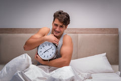 The man having trouble waking up in the morning Stock Photo