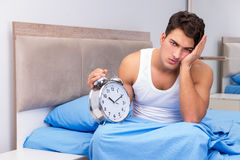 The man having trouble waking up in morning Royalty Free Stock Image