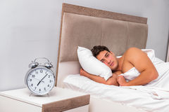 The man having trouble waking up in the morning Royalty Free Stock Image