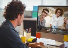 Man having video call with colleagues on computer. In office Royalty Free Stock Images