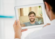 Man having a video call with his friend on digital tablet royalty free stock photos