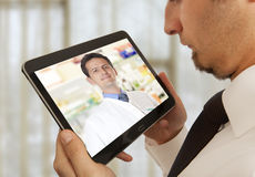 Man having video chat with doctor Stock Image