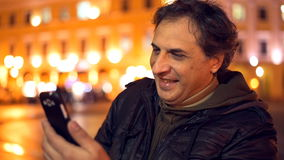 Man having video chat on phone. stock footage