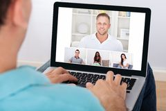 Man having video conference with friends Stock Images