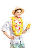 Man in Hawaiian clothes holding a cocktail Royalty Free Stock Photo
