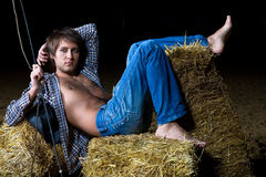 Man in hay Stock Image