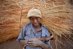 A man with a hay bundle on his back, Ethiopia Stock Image