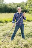 Man on  haymaking Stock Photography