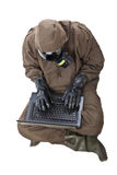 Man in Hazard Suit browsing the internet Stock Image