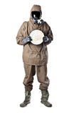 Man in Hazard Suit with a dirty dish. A man wearing an NBC Suite (Nuclear - Biological - Chemical stock images
