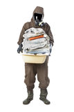 Man in Hazard Suit holding dirty towels and looking at the camer Royalty Free Stock Image