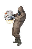 Man in Hazard Suit holding dirty towels. A man wearing an NBC Suite (Nuclear - Biological - Chemical royalty free stock images