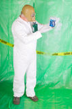 Man in Hazmat clothing in decontamination chamber Stock Photos