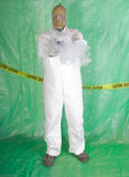 Man in Hazmat clothing in decontamination chamber Royalty Free Stock Images