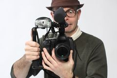 Man with HD SLR camera. Man with an High Definition digital SLR camera with shotgun microphone and separate digital audio recorder Royalty Free Stock Photos