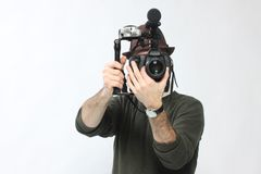 Man with HD SLR camera Stock Image