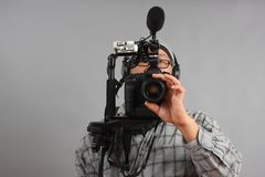 Man with HD SLR camera and audio equipment Stock Images