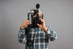 Man with HD SLR camera and audio equipment Stock Photography
