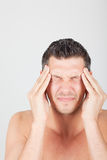 Man head ache. Man holding head having painful migraine Stock Photography