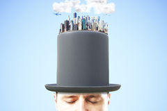Man head in black cylinder with city district on the top. Close up Stock Photos