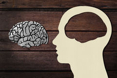 Man head with Brain. Paper Cut of Man Head and Brain on the Wooden Floor Background Stock Images