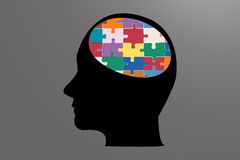 Man head of color puzzle Stock Photography