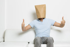Man with head covered giving thumbs up. Royalty Free Stock Image