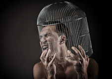 Man with the head inside a birdcage. Concept Royalty Free Stock Photography