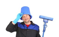 Man with head inside of bucket. Royalty Free Stock Photos