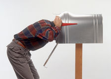 Man with head in mailbox Royalty Free Stock Photo