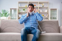 Man with a head neck spine trauma wearing a neck brace cervical Royalty Free Stock Image