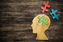Man head silhouette with jigsaw. Puzzle peace Stock Photo