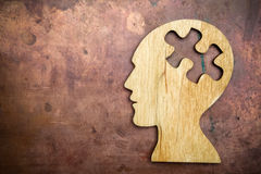 Man head silhouette with jigsaw. Puzzle peace Stock Photos