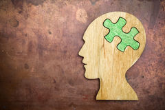 Man head silhouette with jigsaw. Puzzle peace Stock Image