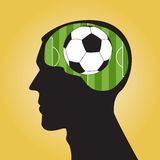 Man head silhouette with a soccer ball Stock Images