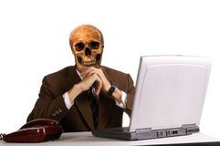 Man in head skull with laptop computer Royalty Free Stock Photos