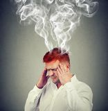 Man with head smoking from problems royalty free stock photography