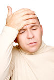 Man with headache. Adult man with headache isolated on white background Stock Photos